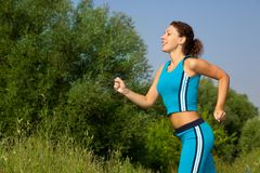 Young attractive woman runs in the country  Stock Images