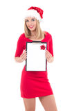 Young attractive woman in santa hat with wish list isolated on w Royalty Free Stock Images