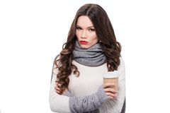 Woman in arm warmers holding cup. Young attractive woman in scarf and arm warmers holding a paper cup, isolated on white stock image