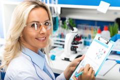 Young attractive woman scientist researching in the laboratory stock photography