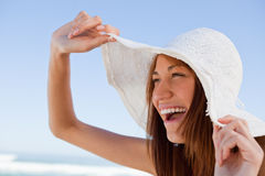 Young attractive woman screaming of joy in front of the sea Royalty Free Stock Images