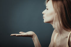 Young attractive woman sending hand kiss. Stock Image