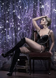 Young attractive woman in sexy lingerie posing in luxury interio Royalty Free Stock Image