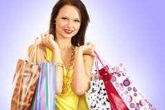 A young and attractive woman with shopping bags Royalty Free Stock Photo