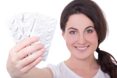 Young attractive woman showing blister of pills isolated on whit Royalty Free Stock Photography