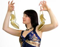 Young attractive woman showing elegant golden shoes with high h. Eels, white background royalty free stock photo