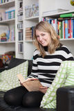 Young, attractive woman sits reads a book Stock Photo