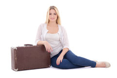 Young attractive woman sitting with brown retro suitcase isolate Stock Image