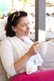 Young attractive woman, sitting in a cafe Royalty Free Stock Photo