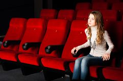 Young attractive woman sitting in a cinema Stock Photos