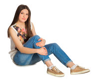 Young attractive woman sitting on floor. Isolated on white background royalty free stock photo