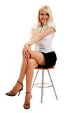 A young attractive woman sitting on stool royalty free stock image