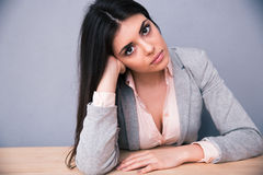 Young attractive woman sitting at the table Stock Photo