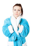 Young attractive woman in sky-blue bathrobe Royalty Free Stock Photos