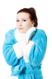 Young attractive woman in sky-blue bathrobe Royalty Free Stock Image