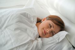 Young attractive woman sleeping in bed at home stock image