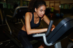 Young attractive woman with a slender figure and dark skin has been cardio workout in the fitness center Royalty Free Stock Image