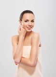 A young and attractive woman in a soft towel Stock Image