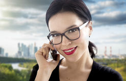 Young attractive woman speaking by mobile phone Royalty Free Stock Photo
