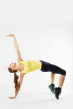 Young attractive woman in sportswear on yoga pose on a white bac Royalty Free Stock Photos