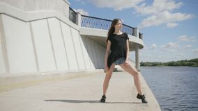 Young attractive woman standing near the river stock video footage