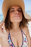 Young attractive woman standing upright with puckered lips Royalty Free Stock Photo
