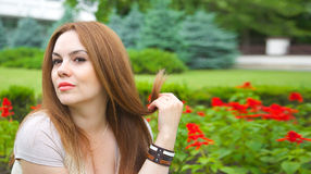 A young attractive woman is starring at something. A young attractive woman in her thirties is starring at something. Copy space Royalty Free Stock Images