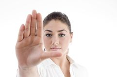 Young attractive woman with stopping gesture. Against white background Royalty Free Stock Image