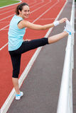 Young attractive woman stretching her leg Stock Images