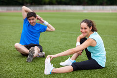Young attractive woman stretching her leg Royalty Free Stock Photo