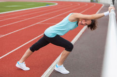 Young attractive woman stretching her leg Stock Image