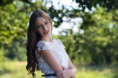 Young attractive woman at summer green park. Royalty Free Stock Images