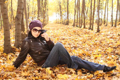 Young attractive woman in sun glasses in park Stock Photography