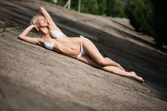 Young attractive woman sunbathing Royalty Free Stock Photography