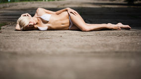 Young attractive woman sunbathing Stock Photos
