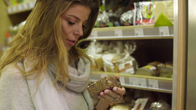 Young attractive woman in a supermarket Stock Photos