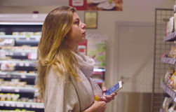 Young attractive woman in a supermarket Royalty Free Stock Image