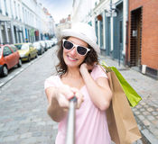 Young attractive woman taking selfie while shopping Royalty Free Stock Images