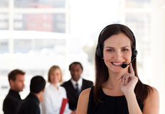 Young attractive woman talking on a headset Royalty Free Stock Photo