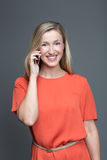 Young attractive woman talking on a mobile phone Royalty Free Stock Image