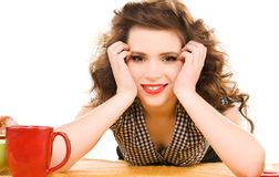 Young attractive woman in te kitchen Royalty Free Stock Photos