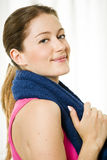 Young Attractive Woman With Towel Around Her Neck Stock Photo
