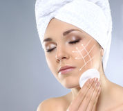 Young attractive woman in towel making the spa treatment Royalty Free Stock Photos