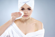 A young attractive woman in towel making the spa treatment Royalty Free Stock Photography
