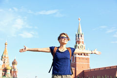 Young attractive woman traveler with backpack on the background Stock Image