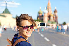 Young attractive woman traveler with backpack on the background Stock Photography