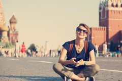 Young attractive woman traveler with backpack and mobile phone o Stock Image
