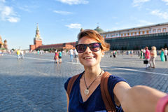 Young attractive woman traveler makes selfie on the mobile phone Royalty Free Stock Images