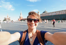 Young attractive woman traveler makes selfie on the mobile phone Royalty Free Stock Photography