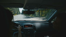 Young attractive woman traveling by car. Cheerful young attractive woman traveling by car stock footage